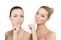 Two beautiful women finger lips showing to keep silence hush Royalty Free Stock Photo