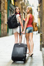Two beautiful women with luggage Royalty Free Stock Photo