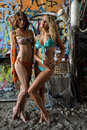 Two beautiful young swimsuit models posing sexy in front of graffiti background with marine style accessories Royalty Free Stock Images