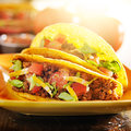 Two beef tacos with cheese, lettuce and tomatoes Royalty Free Stock Photo