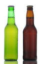 Two beer bottles closeup of one brown and one green both are covered in condensation on a white background with reflection Stock Photography