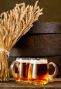Two beer glasses with bundle of wheat