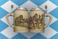 Two beer mugs on the background of the flag of Bavaria Royalty Free Stock Photo