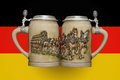 Two beer mugs on the background of the flag Royalty Free Stock Photo