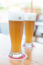 Two beers on table. Royalty Free Stock Photo