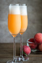 Two bellini cocktails with fresh peaches Royalty Free Stock Photo