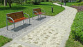 Two benches with stone path in the park Royalty Free Stock Photography