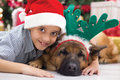 Two best friends boy and dog in christmas night celebrating Stock Image