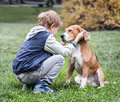Two best friends - boy and his dog Royalty Free Stock Photo