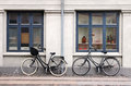 Two bicycles old fashioned leaning against a wall at scandinavian street Stock Photo