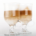 Two big glass mugs with handles of latte coffee macro photo Stock Images
