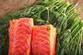 Two big pieces gravlax table over greenery Stock Image