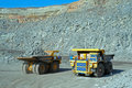 Two big trucks transport iron ore in career Royalty Free Stock Photo