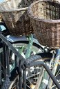 Portrait section of two bicycles in rack with matching brown baskets Royalty Free Stock Photo