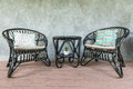 Two black chairs and a coffee table on loft wall background Royalty Free Stock Photo
