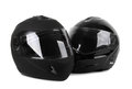 Two black motorcycle helmets isolated Royalty Free Stock Image