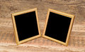 Two blank photo frame on old table Royalty Free Stock Photo