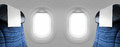 Two blank windows plane with blue seats Royalty Free Stock Photo