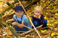 Two blond kids in forest Stock Image