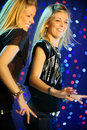 Two blond twins  girls dancing Royalty Free Stock Images