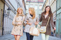 Two blonde and one brunette woman women walking Stock Image