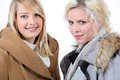 Two blonde women with shelter Royalty Free Stock Photo