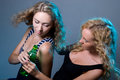 Two blondes with a water bottle Stock Photos