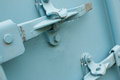 Two blue shipping container locks close up of symbolising toughness Royalty Free Stock Photo