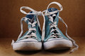 Two blue shoe laces linked on a brown background Royalty Free Stock Photo