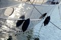 Two boat fenders, protecting the side of a sailing vesselt Royalty Free Stock Photo