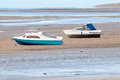 Two boats on the beach at low tide Stock Photos