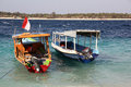 Two boats on blue waves in the ocean. Tropical Gili islands. Royalty Free Stock Photo