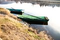Two boats rowing on the shore rowboats at the grassy bank Stock Photo