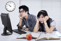 Two bored students studying together Royalty Free Stock Photo