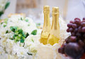 Two bottles of champagne background on festive table Stock Photos