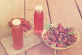 Two bottles of cold stewed fruit from assorted berries. Royalty Free Stock Photo