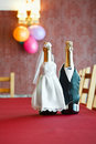 Two bottles of wine in bride and groom clothe Royalty Free Stock Photo