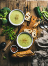 Two bowls of homemade pea, broccoli and zucchini cream soup Royalty Free Stock Photo