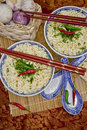 Two bowls with hot asian noodles Stock Images