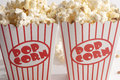 Two boxes of popcorn in a red and white striped box Stock Image