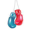 Two boxing gloves hanging Royalty Free Stock Photography