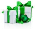 Two boxs tied green ribbon bow and christmas ball isolated white satin on white background Stock Photos