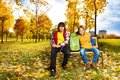 Two boys in autumn park Royalty Free Stock Photo