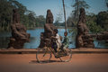 Two boys on a bicycle at the entrance of angkor Royalty Free Stock Photo