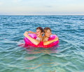 Two boys brothers in a swim ring have fun in the ocean Royalty Free Stock Image