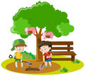 Two boys digging hole in garden Royalty Free Stock Photo