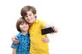 Two boys do selfie isolated on white background Stock Photo