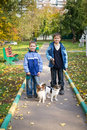 Two boys with dogs Stock Photos
