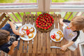 Two boys are eating waffles with strawberries and ice-cream Royalty Free Stock Photo