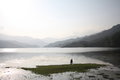 Two boys fishing in a silver lake in Pokhara Nepal Royalty Free Stock Photo
